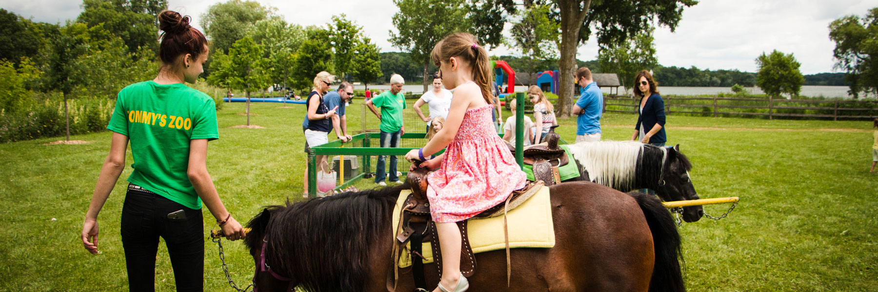 girl riding horse at Long Lake community event